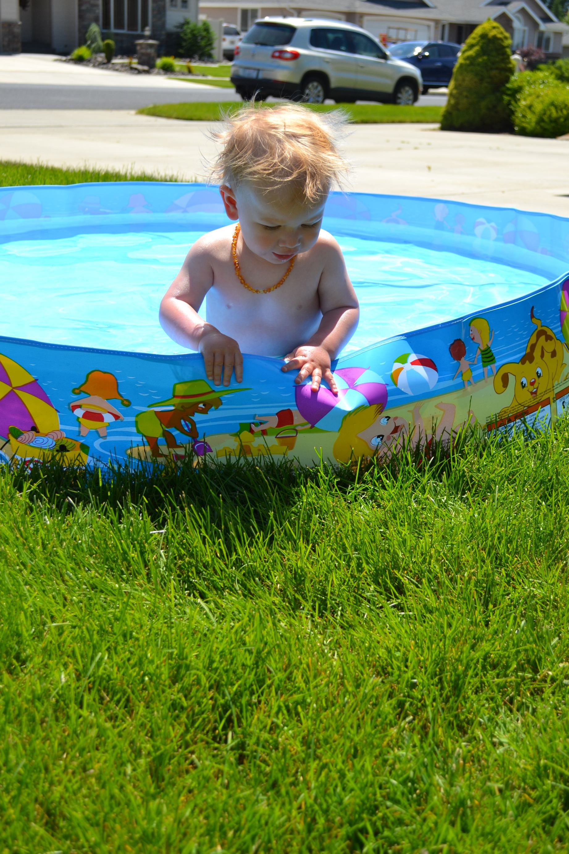 early this month, we pulled out Lincoln's kiddie pool for the first time..