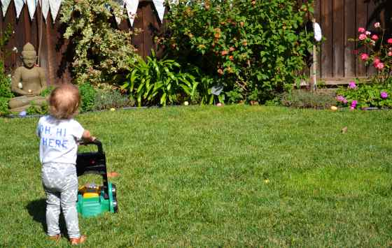 before the Easter Egg Hunt began, Lincoln spent some time mowing the lawn